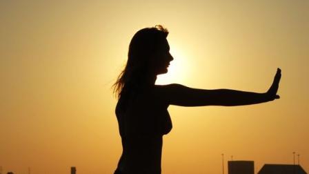 Woman on beach spontaneous qigong