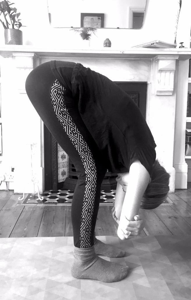 Forward fold knees bent